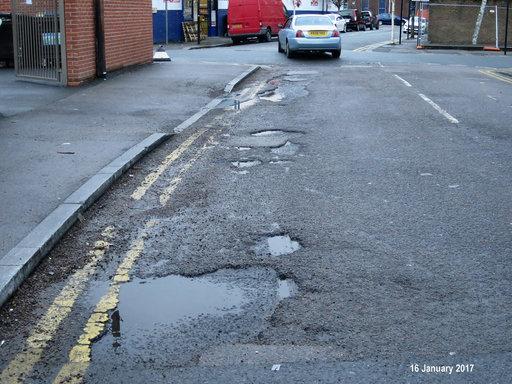 Many potholes on the road